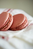 Two Pink Macaroons on a Dish Towel