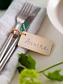 Cutlery on a napkin with a name tag
