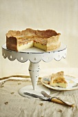 Sundried Tomato Quiche on a White Cake Stand; Slice Removed