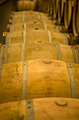 Wooden barrels in a wine cellar (Chateau Lynch-Bages, Frankreich)
