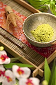 Japanese Matcha Green Tea Powder in a Bowl on Tray; Flowers