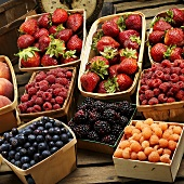 Many Baskets of Fresh Assorted Berries; Scale