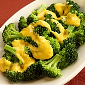 Serving Dish of Steamed Broccoli with Cheese Sauce