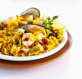 Paella with mussels, shrimp and mushrooms