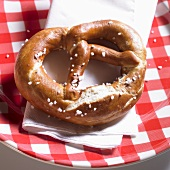 Lye pretzel on a plaid plate