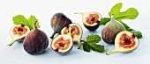 Fresh figs with leaves, whole and halves