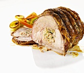 Filled roast pork with leek and bacon