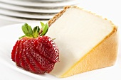 Slice of Cheesecake with Cracker Crust and Sliced Strawberry