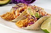 Fried Tilapia Tacos with Slaw, Avocado and Spicy Mayo Sauce