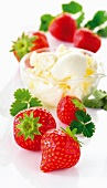 A bowl of vanilla ice cream and fresh strawberries