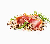 Wild rice salad with bacon and rocket