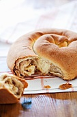 Snail Bread (Bread Roll with Cinnamon and Raisins Shaped Like a Snail); Broken