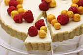 Vanilla tart with cape gooseberries and raspberries