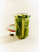 Homemade dill gherkins in an open jar