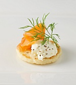 A blini with cream cheese and smoked salmon