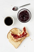 A face made of toast, jam and coffee
