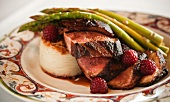 Sliced Seared Duck Breast with Potato Gratin Asparagus and Raspberries