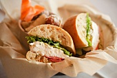 Mozzarella, Tomato and Romaine Sandwiches on Ciabatta; In Paper Lined Basket