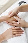 A woman receiving a hand massage