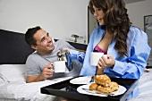 A couple having breakfast in bed