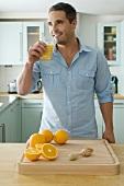 A man drinking freshly squeezed orange juice