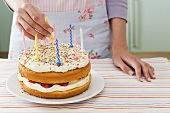 Woman with birthday cake