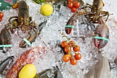 Raw fish and lobsters on ice