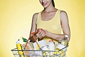 A woman with a basket of groceries