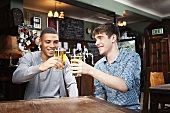 Two young men in a bar