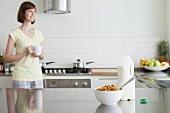 Woman in kitchen at breakfast