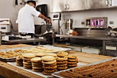 A chef baking cookies in commercial kitchen