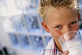 A boy drinking milk