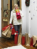 A woman returning home from Christmas shopping