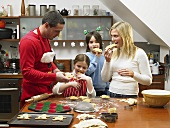 A family eating freshly baked gingerbread men