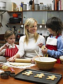 A mother and children making cookies