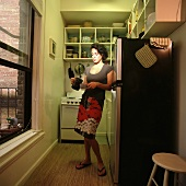 A woman in a kitchen pouring coffee