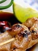 Thai chicken kebab in soy and chili sauce; lime