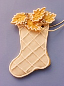Decorated sweet pastry biscuit (boot) as tree ornament