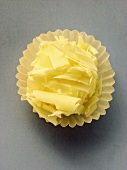 White chocolate truffle in paper case