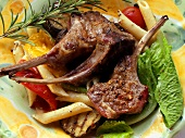 Barbecued lamb chops with pasta and vegetable salad