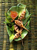Pork and shrimp kebabs with sauce