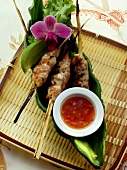Pork and shrimp kebabs with chili sauce