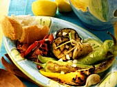 Barbecued vegetables with white bread; lemons