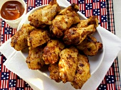 Barbecued chicken wings; barbecue sauce