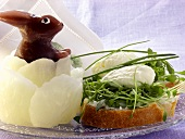 Cream cheese sandwich with cress; wax Easter Bunny