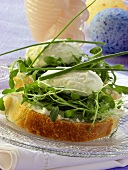 Cream cheese sandwich with cress; Easter eggs