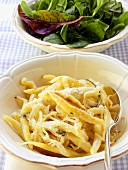 Potato noodles with white cabbage & cream sauce; lettuce