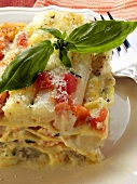 Asparagus bake with salmon, tomatoes and basil
