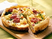 Vegetable quiche with tomatoes and cauliflower, piece cut