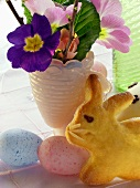 Pastel-coloured Easter eggs, spring flowers & Easter Bunny